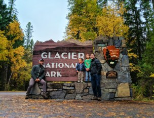 Taylor Family at Glacier National Park sign 3