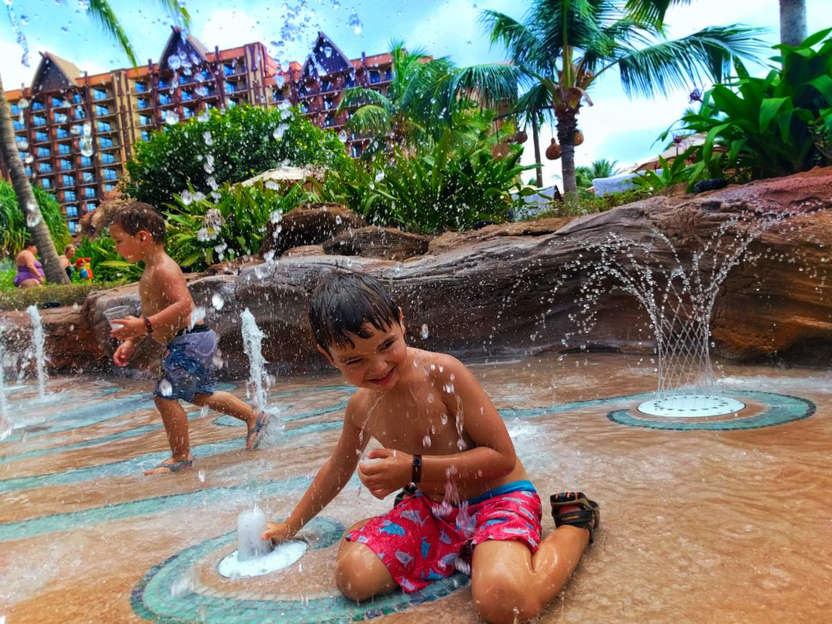 Taylor Family at Splash Pad at Disney Aulani Oahu 1