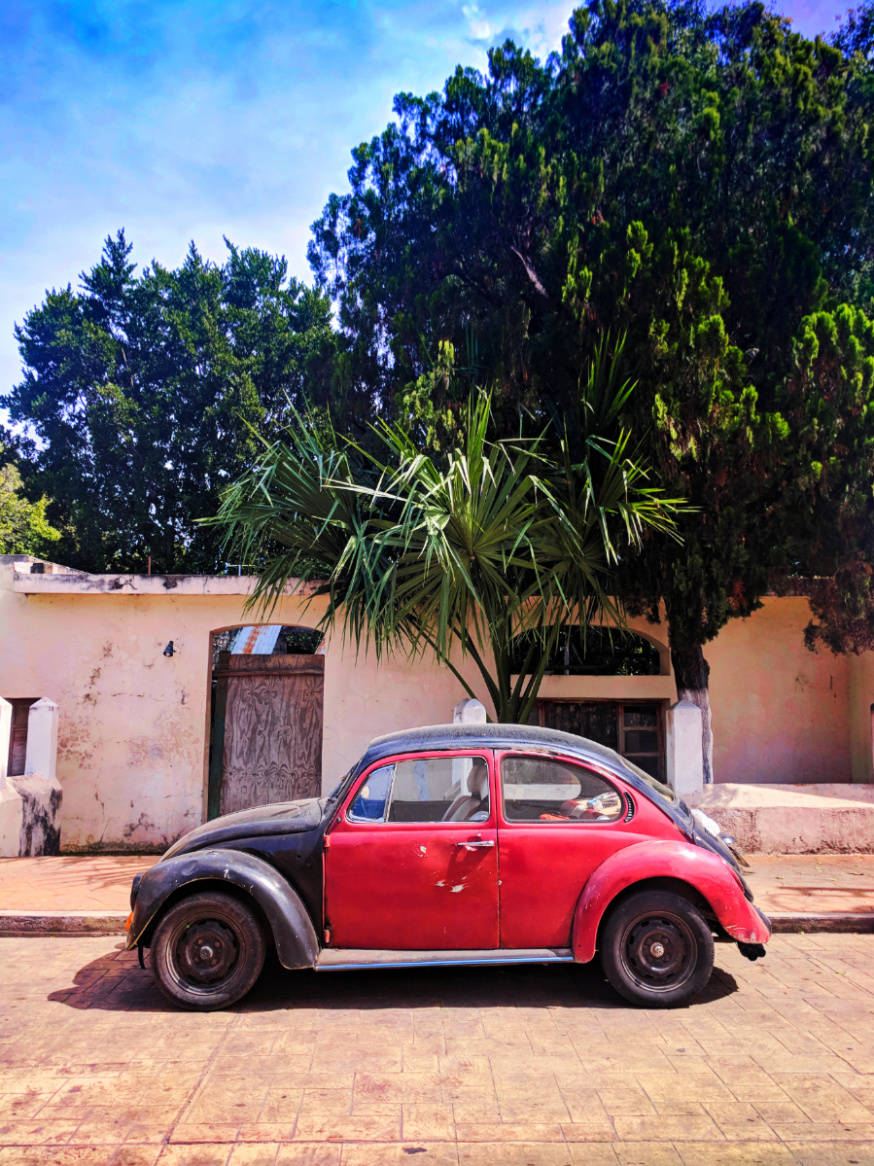 VW Bug and Colorful buildings on sidestreet in Valladolid Yucatan road trip 7