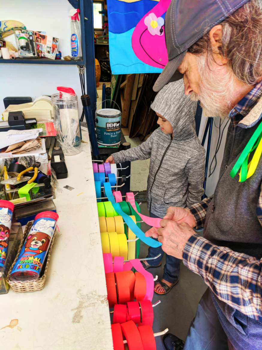 Taylor family buying Kites in Kite shop at Pacific City Oregon Coast 2