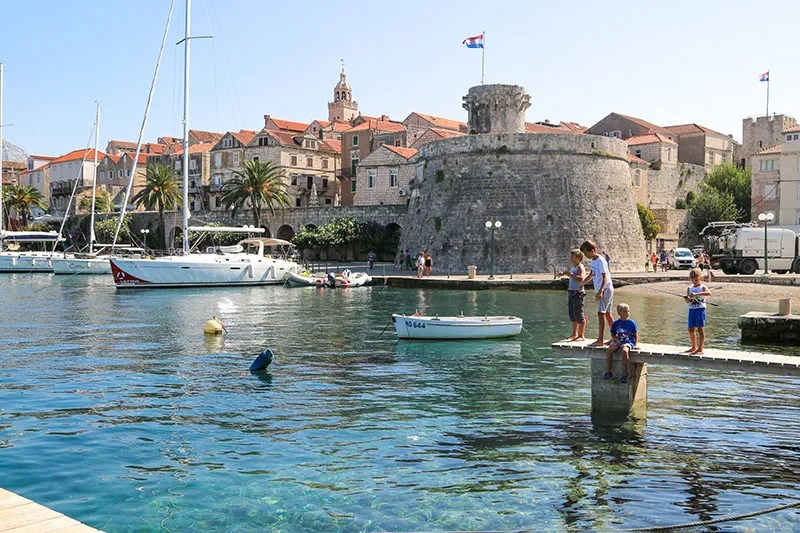 Kids fishing in Korcula