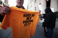 People protest in front of the U.S. Courthouse where Detroit's bankruptcy trial occurred on Oct. 23, 2013. Photographer: Bill Pugliano/Getty Images