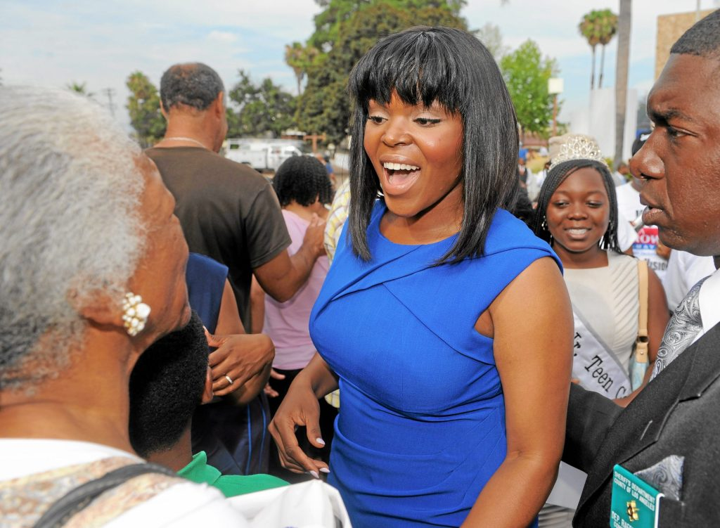 COMPTON - 07/02/2013  (Photo: Scott Varley, Los Angeles News Group)  The city of Compton swore in its new Mayor Aja Brown, council members and staff in a ceremony Tuesday afternoon in the courtyard of the Compton Civic Center. After the swearing-in ceremony, Mayor Brown greets her family and supporters.
