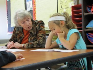 Picture: RSVP Volunteer Christine Giese with Mrs. Shepherd's Kindergarten students.