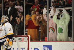 Nashville Predators vs. Chicago Blackhawks CHICAGO, IL - OCTOBER 31: Fans dressed in costumes pound on the glass at Pekka Rinne #35 of of the Nashville Predators after a score by the Chicago Blackhawks at the United Center on October 31, 2011 in Chicago, Illinois. (Photo by Jonathan Daniel/Getty Images)