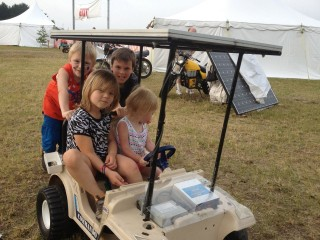 Kids on the Solar PowerWheels Jeep.