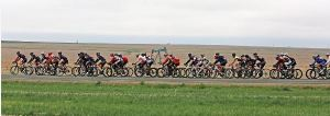 Picture of the peloton and oil derrick by Reid Neureiter