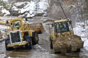 Pay loaders move rocks and dirt in Left Hand Creek  ( Lewis Geyer / Staff Photographer )