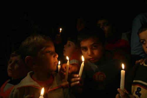 Some Palestinian chidlren lighting thier candles in the Gaza city showing the electricity cut troubles their daily life.