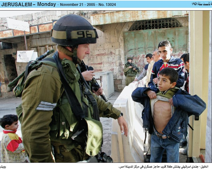 Israeli soldier forcing a kid to stop for searches(West Bank)