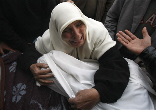 Palestinian mother cry over her husband death body who was killed in the last war on Gaza,North Gaza.