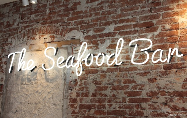 Sharing Food with Friends at the Seafood Bar in Amsterdam Old South