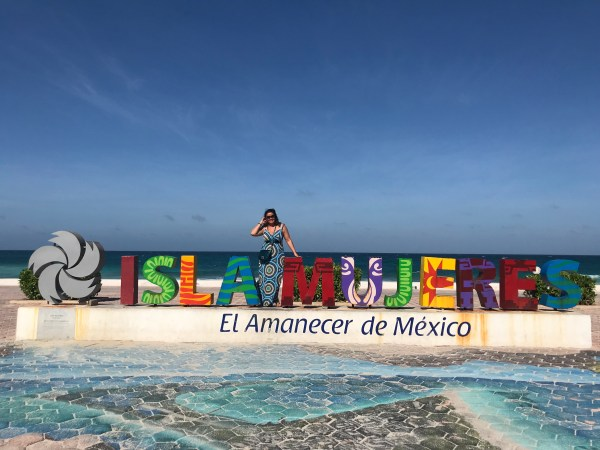 Louise at Isla Mujeres sign