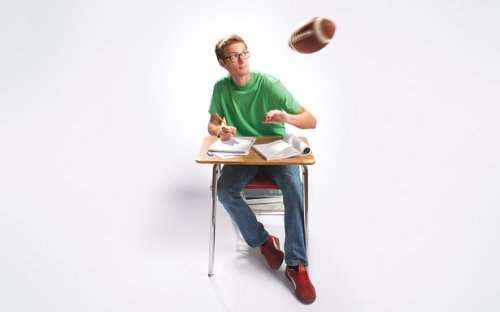Image: Student at desk with incoming footbal