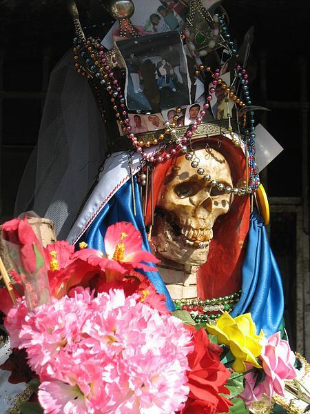 a-la-maquina:</p> <p>Santísima Muerte</p> <p>LA SANTA MUERTE — ANGEL OF DEATH<br /> The ANGEL OF DEATH makes an appearance in Oasis, Florida.<br /> She brings death and revenge for her followers.<br /> Come worship her or be ready to die.<br /> THE DEAD GAME by Susanne Leist