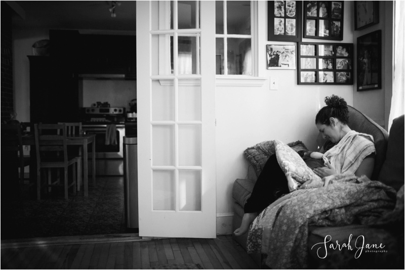 Breastfeeding at home photograph black and white