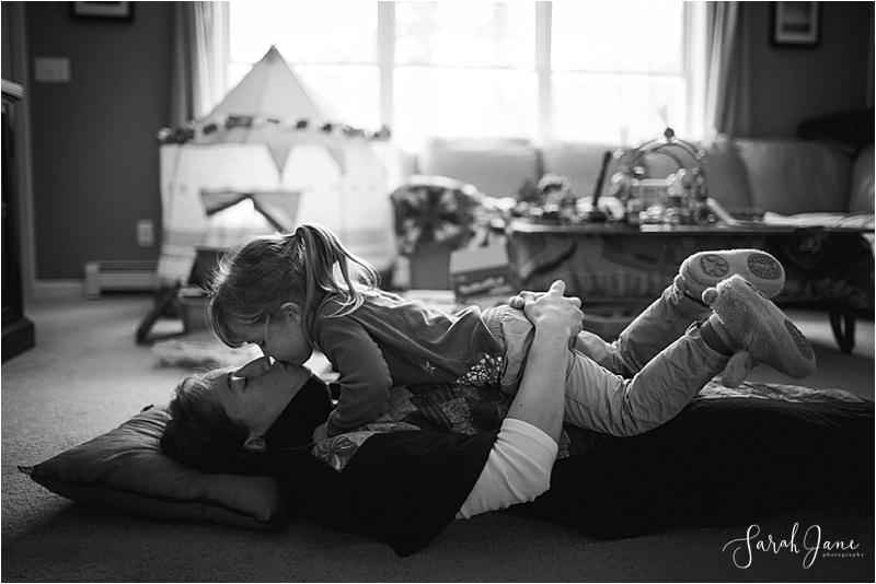 Mom and Daughter kiss Sarah Jane Photography