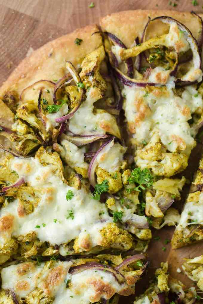 Overhead shot Pizza with Curry Roasted Cauliflower