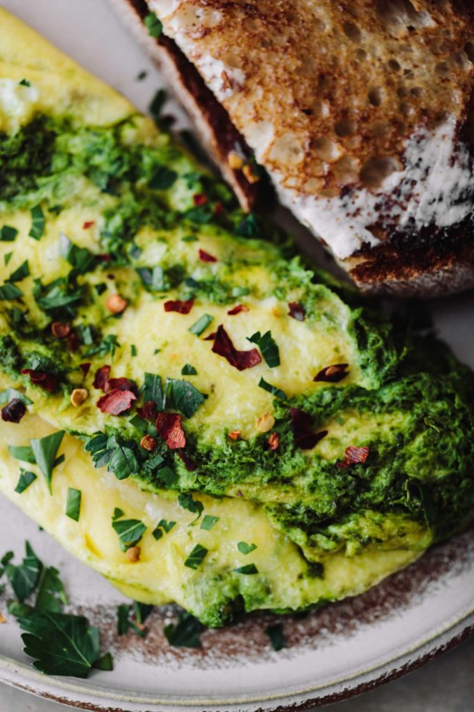 Close-up photograph of kale sauce omelette with manchego cheese.