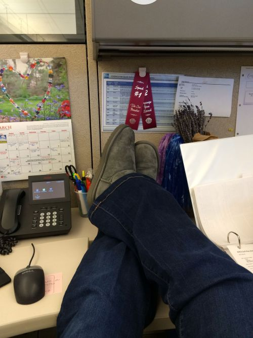 Combatting the post-11 hour flight pregnancy foot swell (ewww so gross where did my ankles go) by kicking back at work.