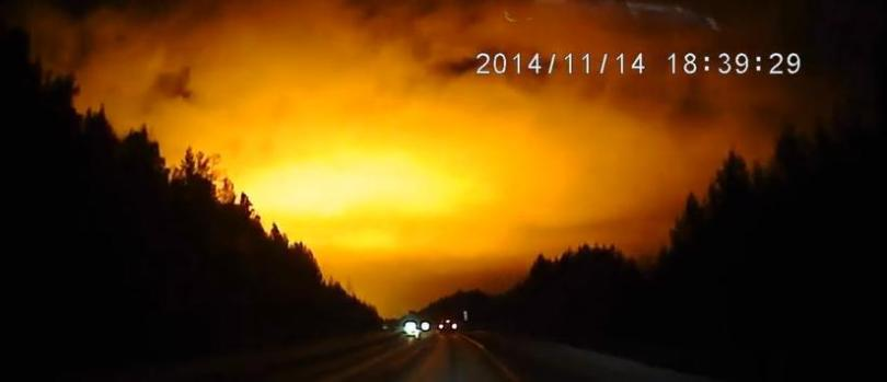 Something really big and bright exploded in the Ural Mountains.. It turned a dark night sky bright orange and yellow. A dash cam caught it all, and now it's online for the world to see. At this point, media reports indicate, officials are mum on what exactly it was.. But that dashcam is clear: Something big has happened.. And it lit up the sky in an impressive way..