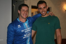 Dan Chambers (right) presents Cody Chadwick (left) with a Hethersett Hawks top.