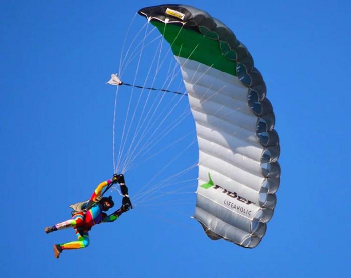 skydiver landing his parachute