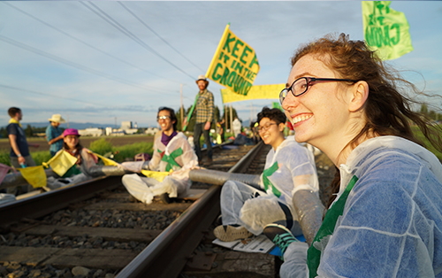 Fighting for Climate Justice, Community members prevent oil trains from moving at Shell and Tesoro Anacortes refiners. Part of Breakfreepnw.org