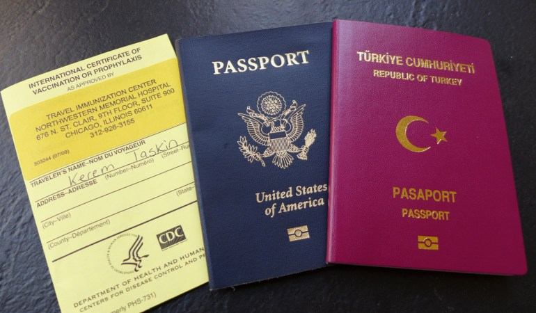 Yellow card, US passport and Turkish passport
