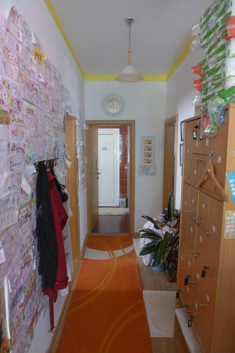 Name tags taped along the corridor wall