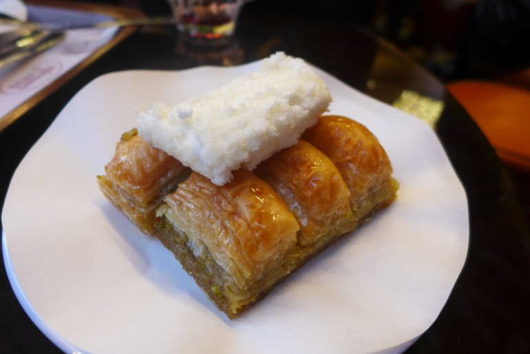Baklava served with kaymak, a thick, sweet clotted cream