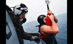 The rescue sling was one of three methods used in rescuing passengers. This picture shows the correct way to use the sling.