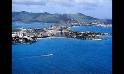 St. Maarten airport. This is the same view the crew would have had in better weather. The runway in this picture is several thousand feet longer than it was in 1970.