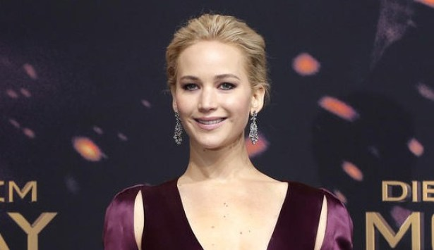 Actress Jennifer Lawrence poses for the photographers as she arrives for the World premiere of the movie 'The Hunger Games: Mockingjay - Part 2' in Berlin, Germany, Wednesday, Nov. 4, 2015. (AP Photo/Michael Sohn)