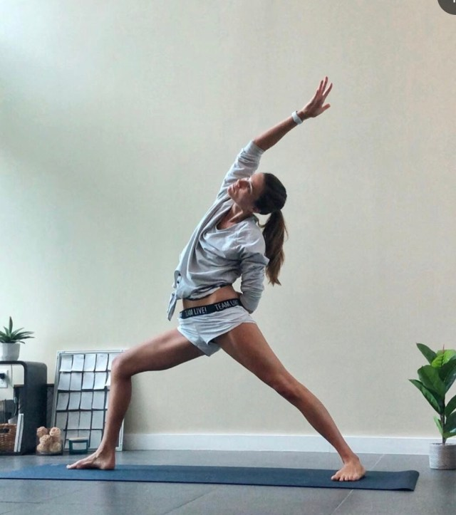 yoga as medicine sara on her yoga mat