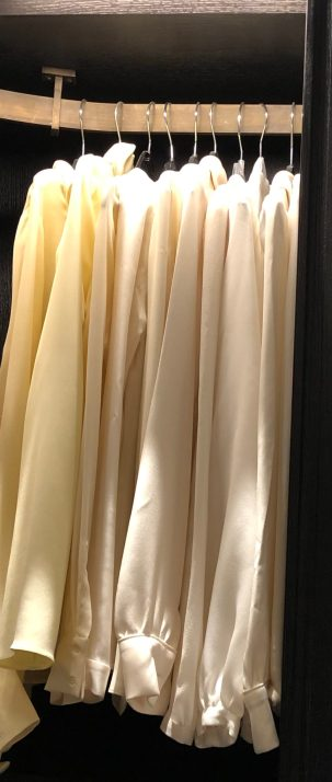In her wardrobe Jane's clothes are divided into sections - here  blouses and shirts are grouped together