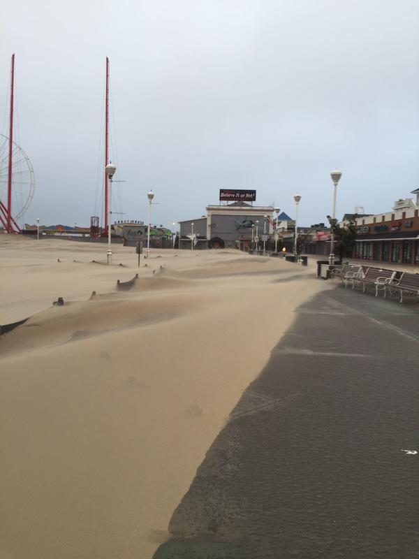 This image was published by   MarylandWeather4cast .. it shows the scene in Ocean City, where the sand has forgotten its place and taken over the boardwalk thanks to ocean help..