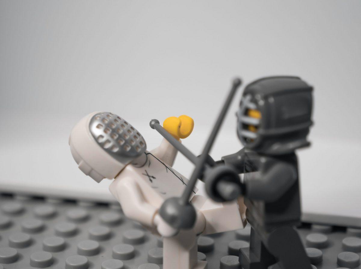 image of 2 figures fighting