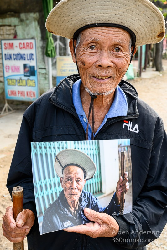 Ranh with his photo Hoi An, Vietnam