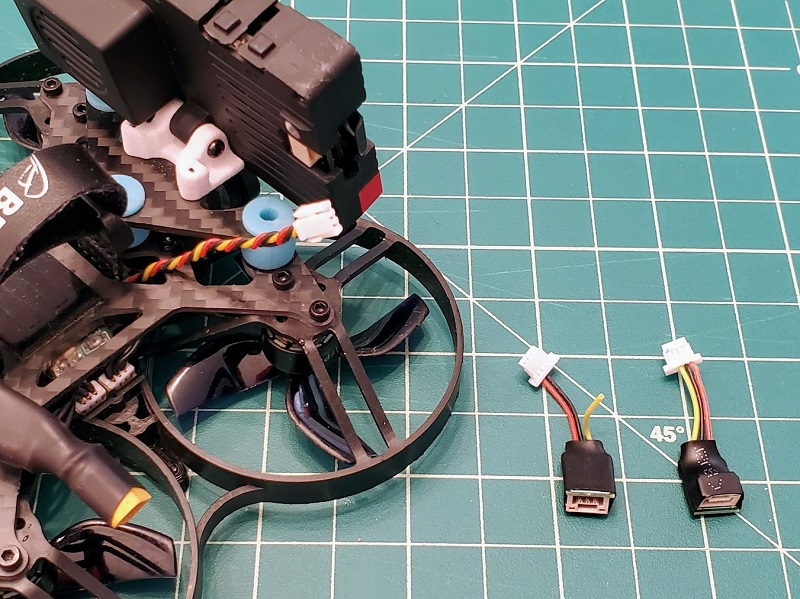 Use the Insta360 SMO adapter for quads that have a naked GoPro power cable