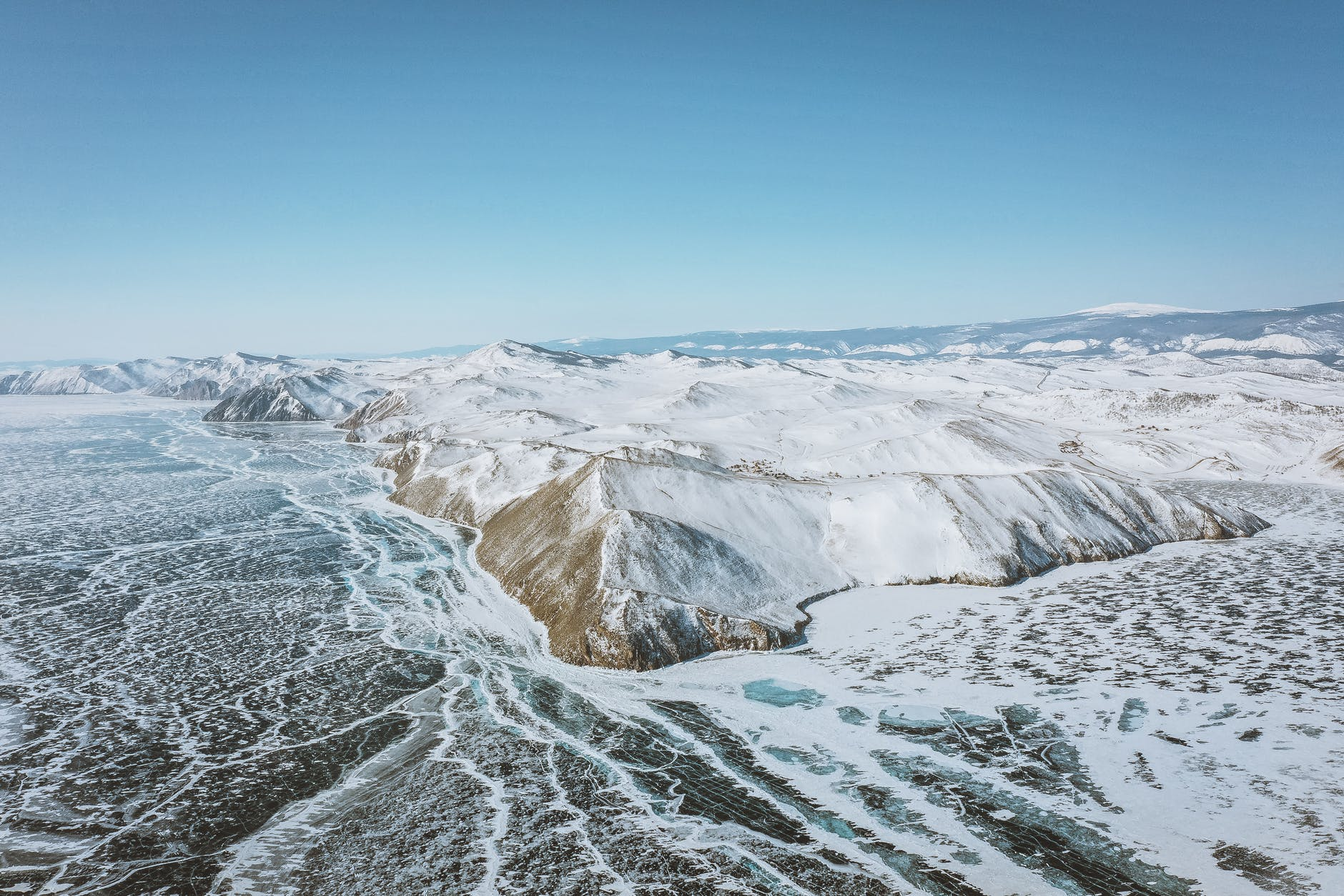 snowy mountains on icy sea in winter