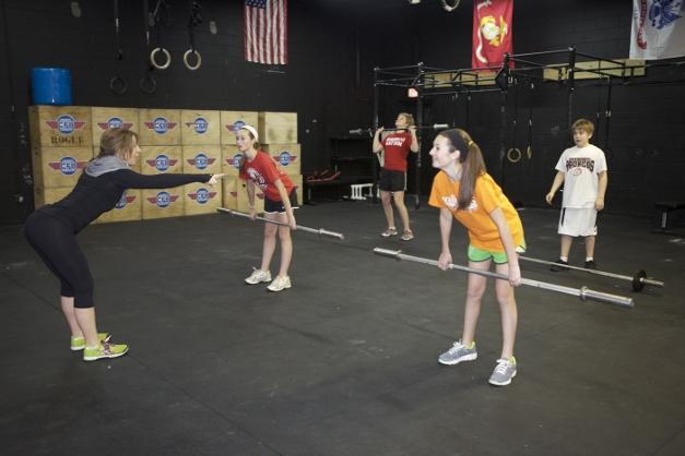 Coach Kaia teaching a teen class - Photographed by Julie Linnekin