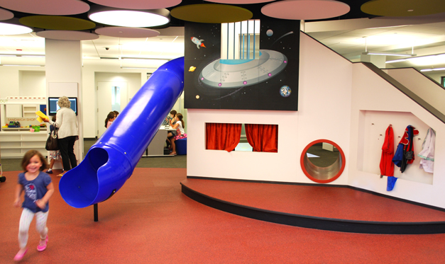 The Playhouse Stage and slide continue to captive kids at the Barrington Area Library
