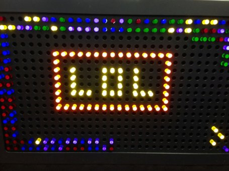 Photograph of the letters LOL on a Light Bright Wall