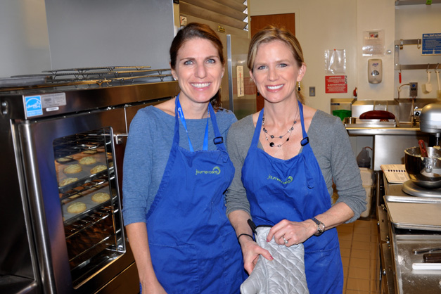Sisters Jennifer Kainz and Julie Baily baking in the JourneyCare kitchen - Photo by Liz Luby
