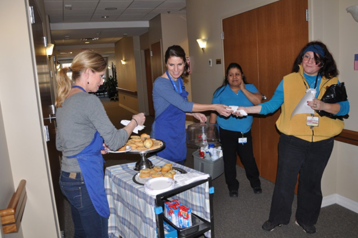 The baking sisters hand out cookies to JourneyCare staff - Photo by Liz Luby