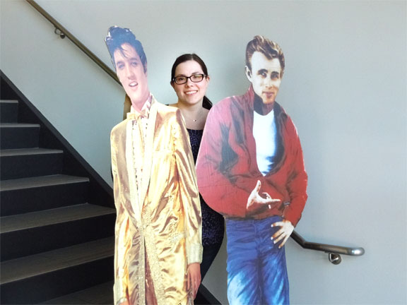 Librarian Liz Kirchhoff poses with some famous friends as she prepares for the library's Family Sock Hop on February 13.
