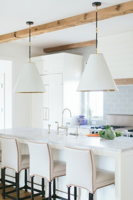 White cabinets, marble counters, rustic wood & metals