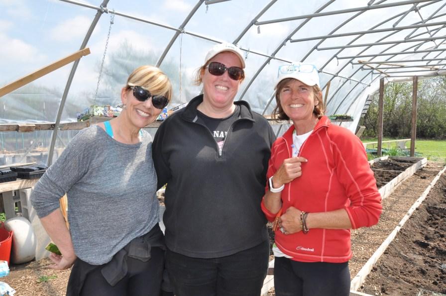 A volunteer, Meg Mitchell and Kathy Gabelman at Smart Farm