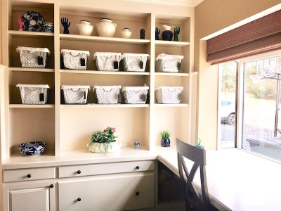 nook with baskets off kitchen used for storage